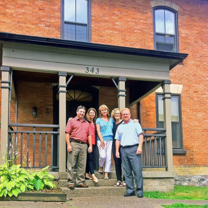 Tom Bennett, Sheri Dietrich, Kendra Buckton, Cathy Burningham, and Ben Shaunghnessy at the Stoneguide Realty office at 343 Stewart Street in Peterborough