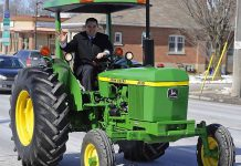 Peterborough MP Dean Del Mastro drives a tractor when announcing plans for a tractor parade to open the 2013 Peterborough Exhibition (photo: deandelmastro.ca)