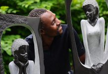 "ZimArt's 2014 artist-in-residence Vengai Chiwawa poses with his ""Romeo and Juliet"". A remarkably similar story to the Shakespeare play is told in Zimbabwe. (Photo: Paul Hodgkinson)"