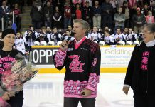 "Celebrity sports anchor and honourary co-chair Dan O'Toole speaks at the pre-game ceremony for the 6th annual ""Pink in the Rink"" along with Anita Blackbourn (who is battling breast cancer) and Anita Record or the Canadian Cancer Society Manager (photo: Pearl Dixon/Peterborough Petes)"