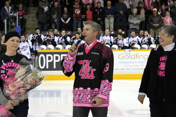 """Celebrity sports anchor and honourary co-chair Dan O'Toole speaks at the pre-game ceremony for the 6th annual """"Pink in the Rink"""" along with Anita Blackbourn (who is battling breast cancer) and Anita Record or the Canadian Cancer Society Manager (photo: Pearl Dixon/Peterborough Petes)"""