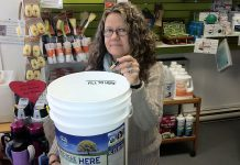 You can drop your old household batteries for free at the Peterborough GreenUp Store, as demonstrated by store manager Ausma Clappison. They'll be sent away for safe disposal and recycling, keeping them out of the landfill. (Photo courtesy of Peterborough GreenUp)