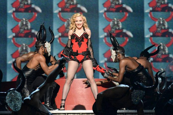 """Madonna performing at the 57th Annual Grammy Awards: """"The disgusting comments towards her age and behaviour at the Grammys in February were some of the most regressive made towards a woman in recent memory."""" (Photo: Kevin Mazur)"""