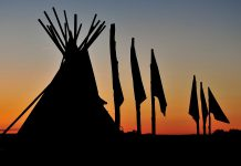Photographs by Georgie Horton-Baptiste and George Campana are on display at two locations this month during the SPARK Photo Festival, like this tipi with flag poles at Pine Ridge Reservation in South Dakota (photo: George Campana)