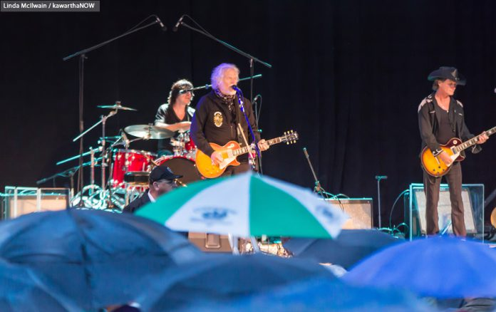 Despite heavy rain, Randy Bachman performed at the opening concert of the 29th season of Peterborough Musicfest on Saturday, June 27 (photo: Linda McIlwain / kawarthaNOW)