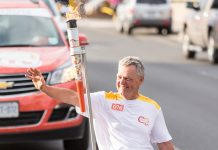 Warsaw Paralympian archer Alec Denys was the final torchbearer and carried the flame into Del Crary Park to light the community cauldron