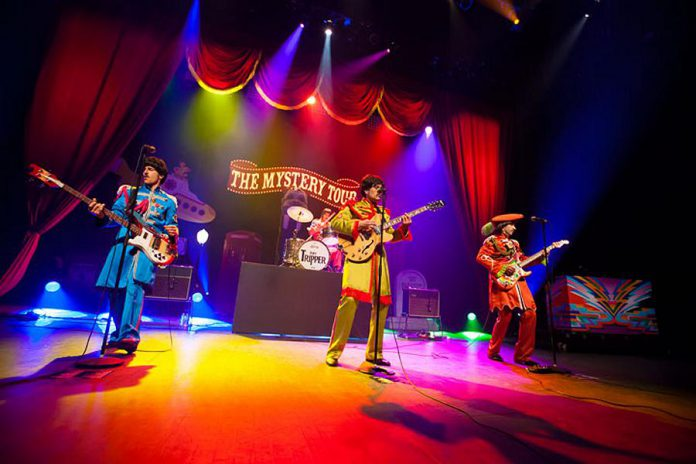 Tribute band Day Tripper performs note-for-note recreations of The Beatles' songs using authentic instruments and costumes