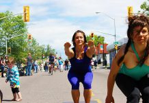 A woman practices yoga on the street at Open Streets in Thunder Bay. Peterborough's first open streets events, Peterborough Pulse, kicks off at 9 a.m. on July 18. Peterborough will open up selected city streets to a variety of fun activities and events, creating a vibrate, playful, and active car-free corridor between Peterborough's downtown and the Saturday Farmers' Market. (Photo: CNW Group/Open Streets Toronto)