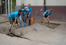 In Peterborough's first Depave Paradise project in June 2014, volunteers remove asphalt in front of the Brock Mission to prepare to transform the space into a garden
