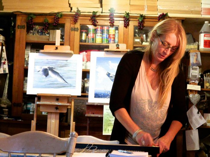 Artist Victoria Wallace at work in her studio where realism and her fascination with surrealism and the circus often collide. Wallace is one of the artists you can see in the Kawartha Autumn Studio Tour during the first weekend of fall.