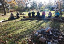 GreenUP Ecology Park volunteers gather around the campfire sharing memories from the gardening season and a hot cup of coffee.