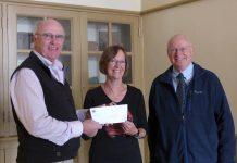 Paul and John Downs of Nexicom present a $5,000 cheque to Celia Hunter of the Millbrook & Cavan Historical Society (photo courtesy of Nexicom)