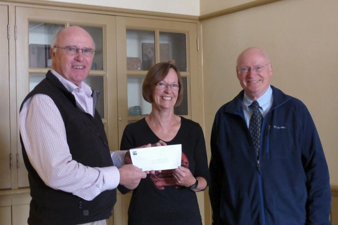 Paul and John Downs of Nexicom present a $5,000 cheque to Celia Hunter of the Millbrook & Cavan Historical Society (photo courtesy of Nexicom)