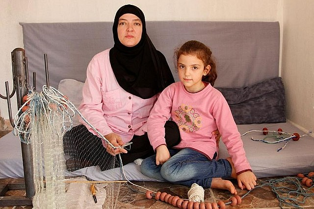 Since the Syrian civil war began in 2011, more than four million refugees have fled Syria for other countries, such as this family living in Lebanon (photo: Wikipedia)