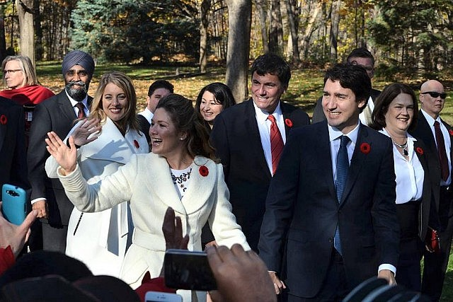 Peterborough-Kawartha MP Maryam Monsef accompanying Prime Minister Justin Trudeau and other MPs to the swearing-in ceremony at Rideau Hall on November 4, 2015 (photo: Steve Boyton for kawarthaNOW)