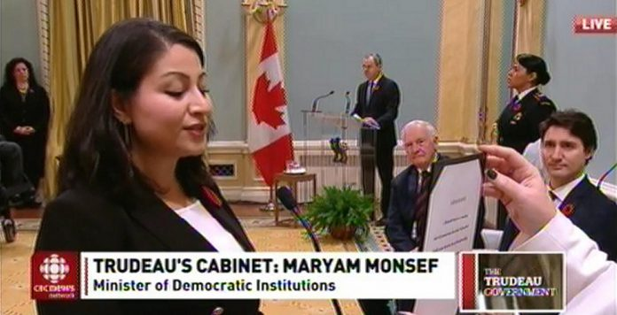Peterborough-Kawartha MP Maryam Monsef being sworn in as Minister of Democratic Institutions as Prime Minister Justin Trudeau looks on (photo: CBC Television)