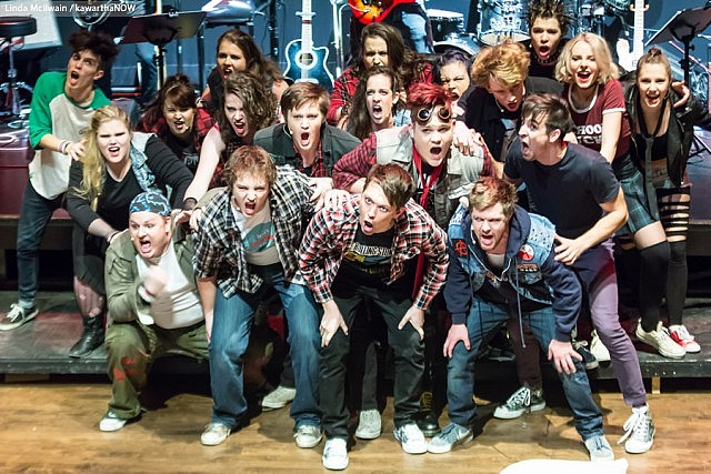 "The cast of ""American Idiot"" with Andrew Little (Will), Ryan Hancock (Johnny), and Taylor Beatty (Tunny) in the first row. The production, featuring the music and lyrics of Green Day, ran for six performance only at Peterborough's Market Hall in December. (Photo: Linda McIlwain / kawarthaNOW)"