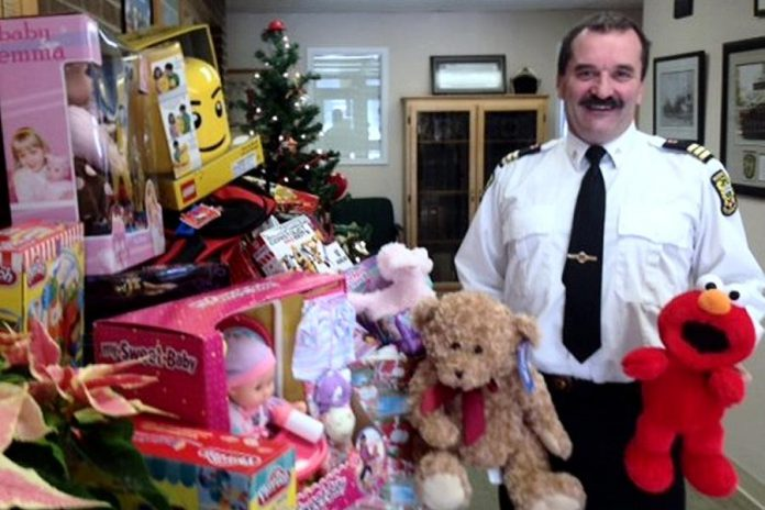 Chief training officer David Braun of Peterborough Fire Services with toys already donated. The firefighters are also giving $1,700 to The Toy Shop, which through the efforts of owner Jean Grant will translate into $3,000 worth of toys (Photo courtesy of Peterborough Fire Services)