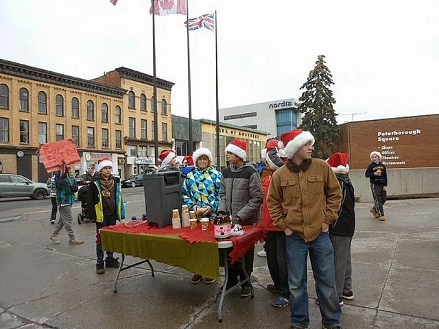 The class set up outside Peterborough Square and ready to spread some Christmas cheer