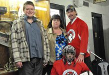 Cathie and Dave Tuck, founders of the Peterborough Huskies special needs hockey team, with their sons Jeffrey (left) and Criss (photo courtesy of the Peterborough Huskies)