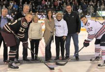 Manon Rhéaume, the first and only woman to play in the NHL, drops the ceremonial puck alongside Susan Dunkley of the Alzheimer Society. Although the Petes lost 4-3 to the Oshawa Generals, the event raised over $16,000 for the Alzheimer Society. (Photo courtesy of the Peterborough Petes)