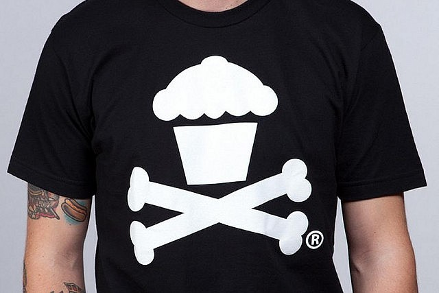 This cupcake-with-crossbones logo remains the design most identified with the Johnny Cupcakes brand