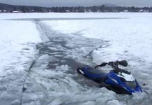 This photo from the Lifesaving Society of Ontario demonstrates one of the most common snowmobile accidents: falling through ice when conditions are either unknown or unsafe. (Photo: Lifesaving Society of Ontario / Facebook)
