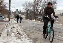 If you're used to dressing up warmly to shovel your driveway, you likely already have all the clothing you need to get out on your bike for Winter Bike to Work Day on February 12th. GreenUP's Brianna Salmon stays warm and dry while winter biking with good mitts, windproof pants, and water-proof boots. (Photo: Karen Halley, GreenUP)