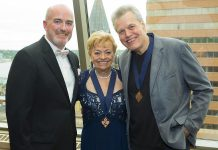 Dianne Leigh receiving her 2015 Medal of Honour from Canadian Country Music Hall President Don Green and 2014 Hall of Fame Inductee Wendell Ferguson (photo: Grant Martin Photography / CCMA)
