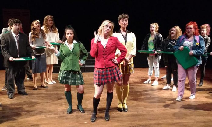 """Hope Clarkin as Heather Duke, Audrey Massender as Heather Chandler, and Jesse Morrison as Heather Macnamara in The Anne Shirley Theatre Company's production of """"Heathers: The Musical"""""""