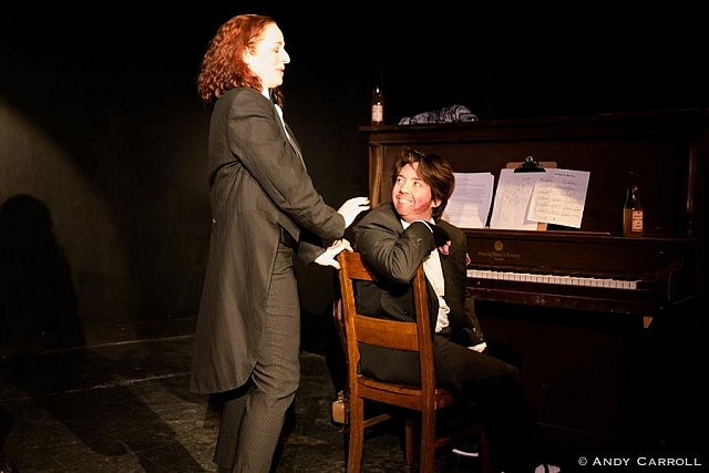 Director Em Glasspool also performs as Cathy's drunken musical accompanist Dickie
