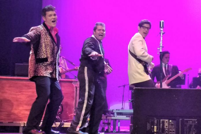 """Liam Parker as The Big Bopper, Lucas DeLuca as Richie Valens, and Matt Diamond as Buddy Holly in the Peterborough Theatre Guild production of """"Buddy - The Buddy Holly Story"""" (photo: Sam Tweedle / kawarthaNOW)"""