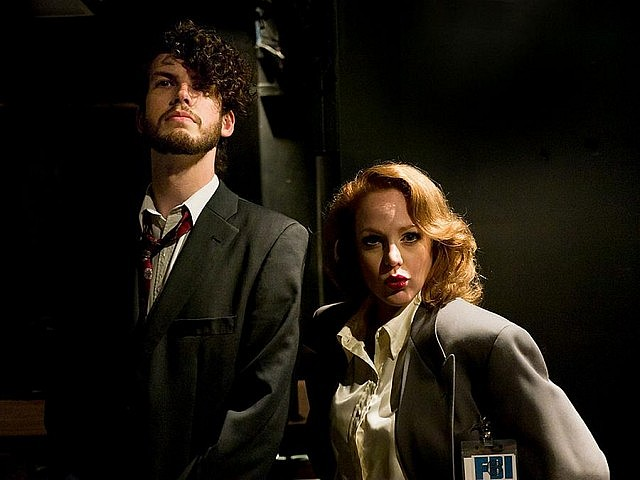 "Sarah McNeilly performing as Dana Scully in an original stage adaptation of ""The X-Files"", along with Spencer Allen (photo courtesy of Andy Carroll"