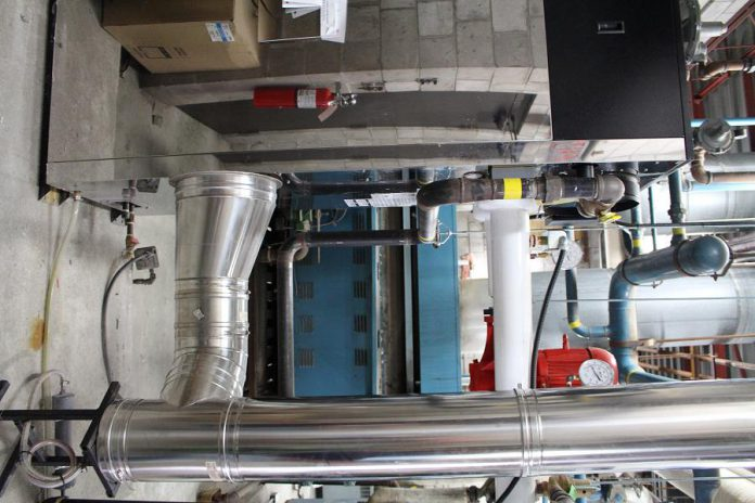 Two new energy efficient boilers, one pictured in the foreground, replace six of the older units (blue unit pictured in background) that were installed when the mall first opened in 1975.