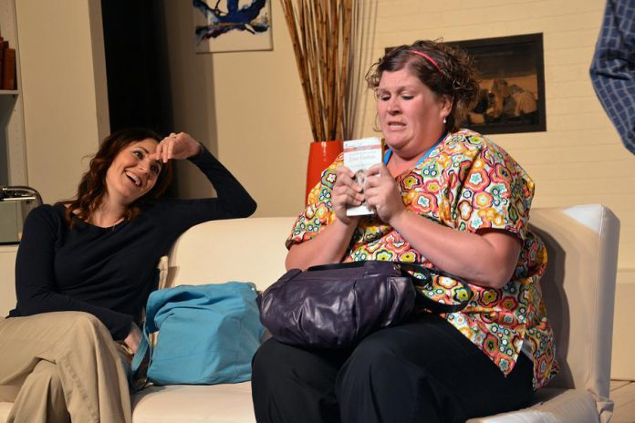 Megan Murphy as Nicole Greenwood and Kate Brioux as Nicole's best friend Janine