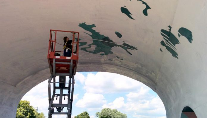 It's not visible in the photo, but the entire mural has been sketched in pencil on the archway. (Photo: Bruce Head / kawarthaNOW)