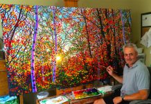 The photo of Tim Packer and his painting that went viral on LinkedIn, causing the site to temporarily suspend his account (photo: Tim Packer / LinkedIn)