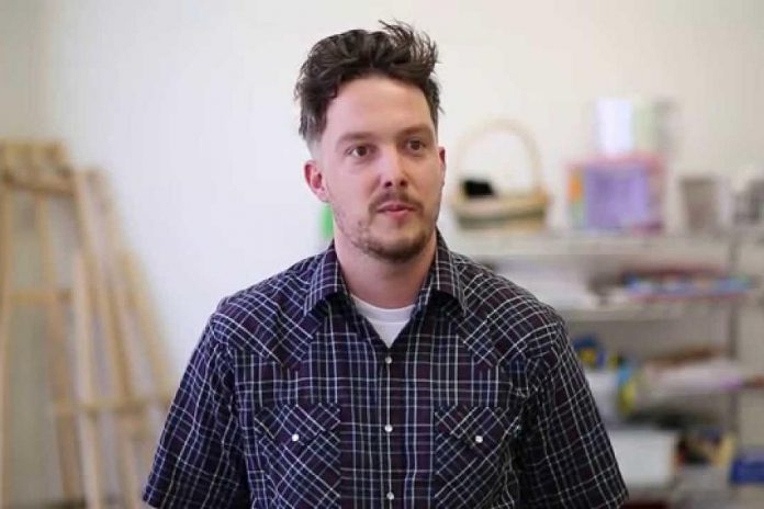Artist Alex Bierk, who will be installing his cloud mural on the east side of the HELP Paralegal at 114 Simcoe Street in downtown Peterborough (photo: Art Gallery of Peterborough / YouTube)