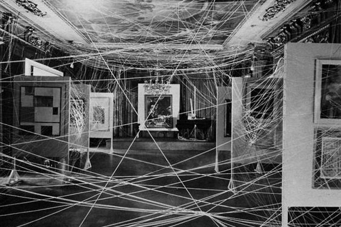 """An image of an installation involving a lot of twine by Marcel Duchamp, for the exhibition """"First Papers of Surrealism"""", 1942. Duchamp is considered one of the forerunners in installation art (photo: John Schiff, courtesy Philadelphia Museum of Art / Art Resource, NY)"""