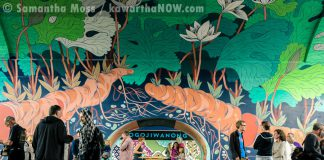 "A public launch on September 1, 2016, was held to celebrate the completion of Edmonton artist Jill Stanton's ""Bloodroot"" mural in an archway under the Hunter St. Bridge. It's adjacent to the ""Electric City Mural"" (pictured in background) completed last year by Toronto artist Kirsten McCrea (photo: Samantha Moss / kawarthaNOW)"