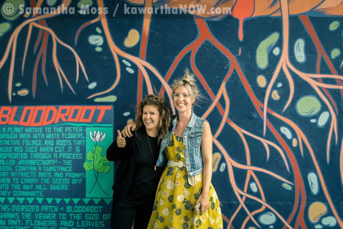 "Artist Jill Stanton with fellow artist Kirsten McCrea, who completed the adjacent ""Electric City"" mural last year (photo: Samantha Moss / kawarthaNOW.com)"