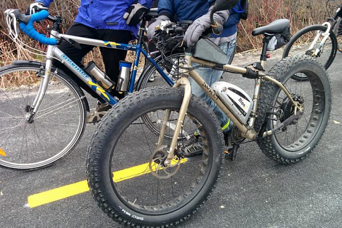 "A Surly ""fatbike"" spotted on the Trans Canada Trail in November 2015. A fatbike is a mountain bicycle with extremely large volume tires for deep snow and sand riding; in this case, the owner has equipped the bike with a Bion pedal assist.  (Photo: Bruce Head / kawarthaNOW)"