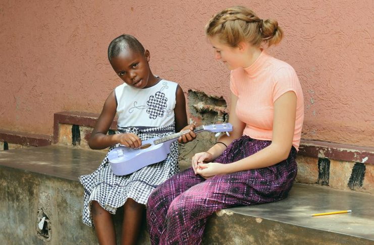 Michelle Bonunu, an eight-year-old Ugandan girl living with Type-1 Diabetes, plays Abigayle Partington's purple ukulele. Abigayle, whose 10-year-old brother Elijah was diagnosed with Type-1 Diabetes last year, travelled to Uganda with her father to volunteer with The Sonia Nabeta Foundation. (Photo: Kristian Partington)