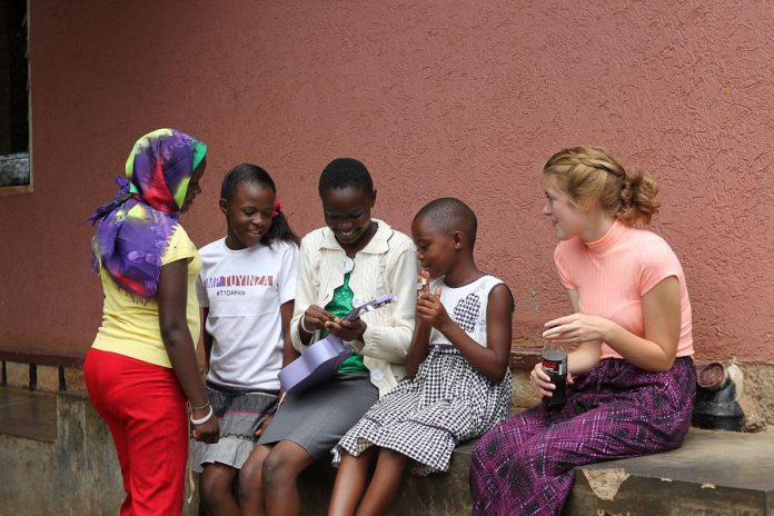 During her two weeks in Uganda, Abigayle discovered that people are very much the same  -- whether they're sharing a love of music or living with Type-1 Diabetes (photo: Kristian Partington)