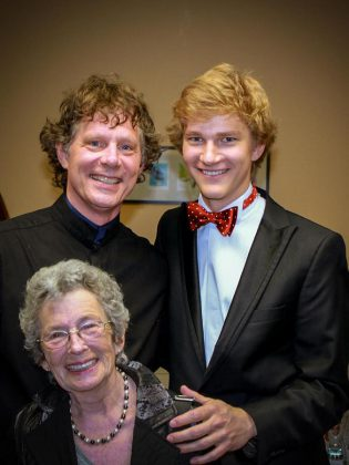 Erica Cherney with Maestro Michael Newnham (standing left) and classical pianist Jan Lisiecki (standing right) after a PSO concert in June 2015