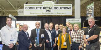 Complete Retail Solutions accepting the Best of Show award from the Canadian Federation of Independent Grocers (CFIG) at Grocery Innovations Canada. Left to right: Dan McMurray (Executive VP Southern CaseArts), Mike Guy (Woodarts), Thomas A. Barlow (President & CEO CFIG), Greg Butler (President, CRS/Pan-Oston), Bennet Foster (President, TechniLite Systems), Stephen Philpott (President, Woodarts), Glen Bonner (VP sales, CRS/Pan-Oston), Phil Golsby (sales, Pan-Oston), Donna O'Brien (VP Sales, Technilite), Dave Powell and Peter Cavin of CFIG, Pete Scanlon (Sales and Marketing CRS/Pan-Oston), and Neil Trineer (VP Sales and marketing Maintech). (Photo courtesy of CRS/Pan-Oston)