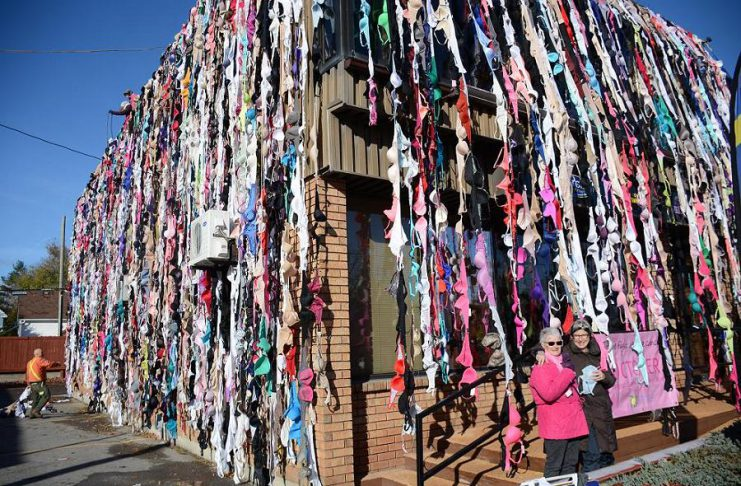 Donna Chamberlain, who alone collected 1,953 bras, with My Left Breast owner Bridget Leslie in front of the Country 105/Energy 99.7 building in downtown Peterborough (photo: Eva Fisher)