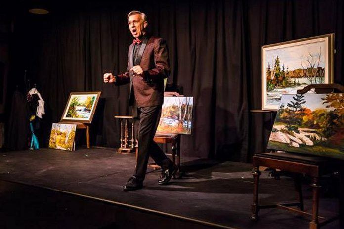 Mark Gray as Myles' personal narrator Bob. The paintings, loaned to the production by local artist Jane Hall, are available for sale after the production run. (Photo: Peterborough Theatre Guild / Facebook)