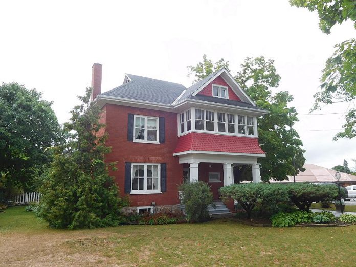 Recently inspected: this beautiful red brick home with an upstairs sunporch in Hastings. (Photo: David Sharman)