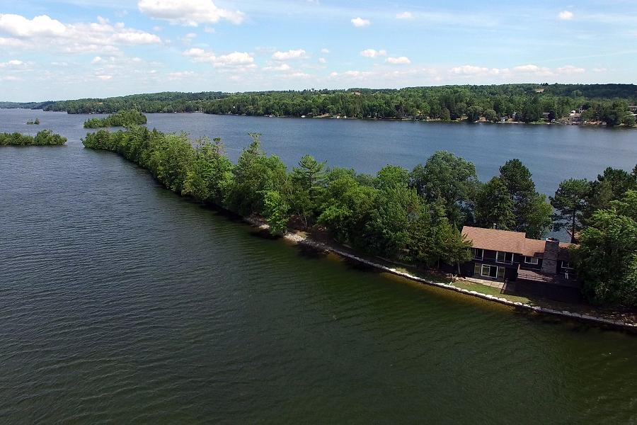 This breathtaking property has a home, a boathouse, 2 outbuildings and 2400 feet of shoreline. (Photo: Scene from Above)